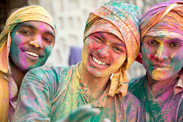 Portrait of Indian men playing holi stock photo