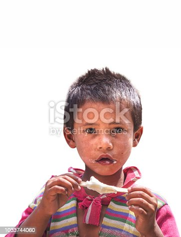 941788480 istock photo Portrait of Indian poor little Boy with Ice Cream isolated on white background 1033744060