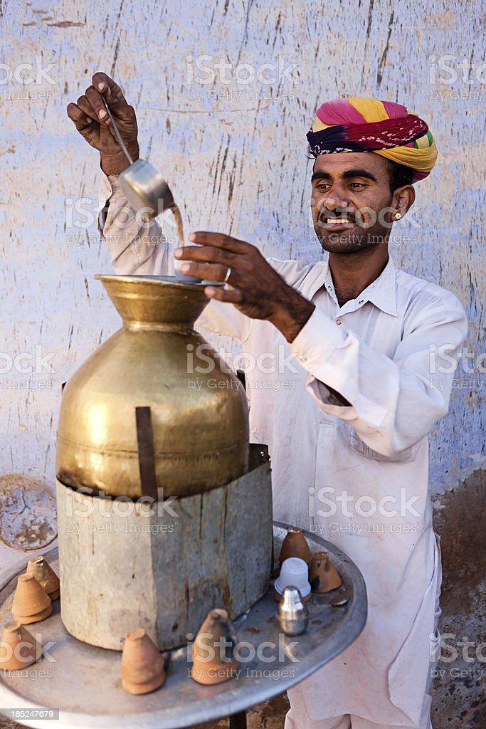 Portrait of Indian street seller selling tea - masala chai stock photo