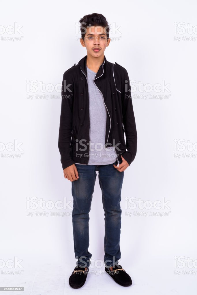 Portrait Of Indian Teenage Boy Against White Background royalty-free stock photo