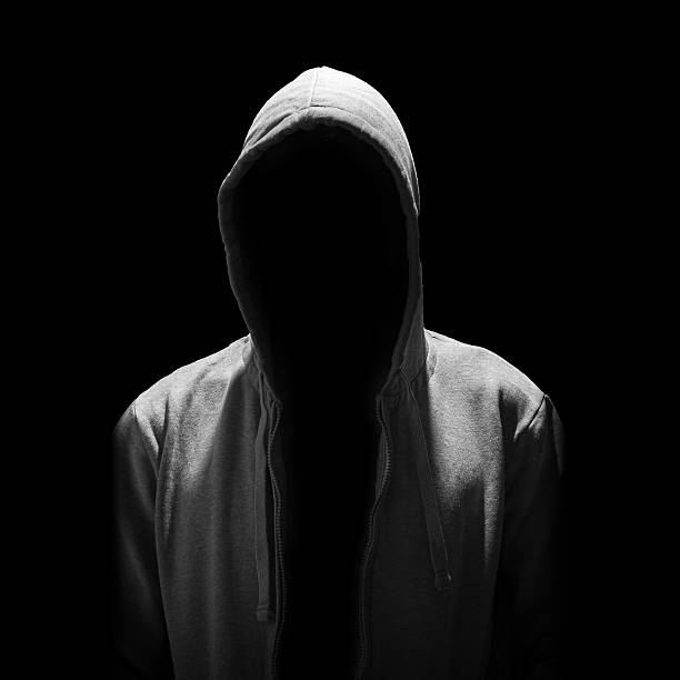 Portrait of Invisible man in the hood isolated on black stock photo
