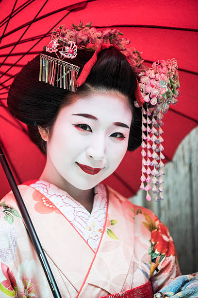 portrait of japanese maiko in traditional make up and kimono - geisha girl stock photos and pictures