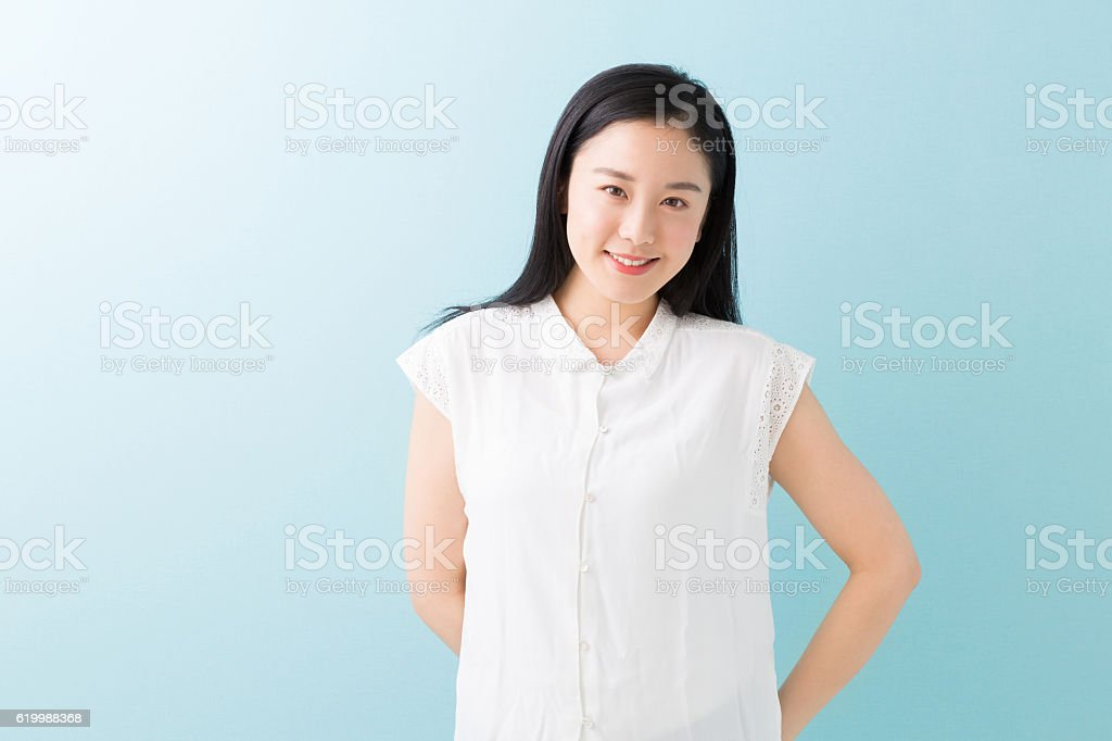 Portrait of Japanese woman in blue background stock photo