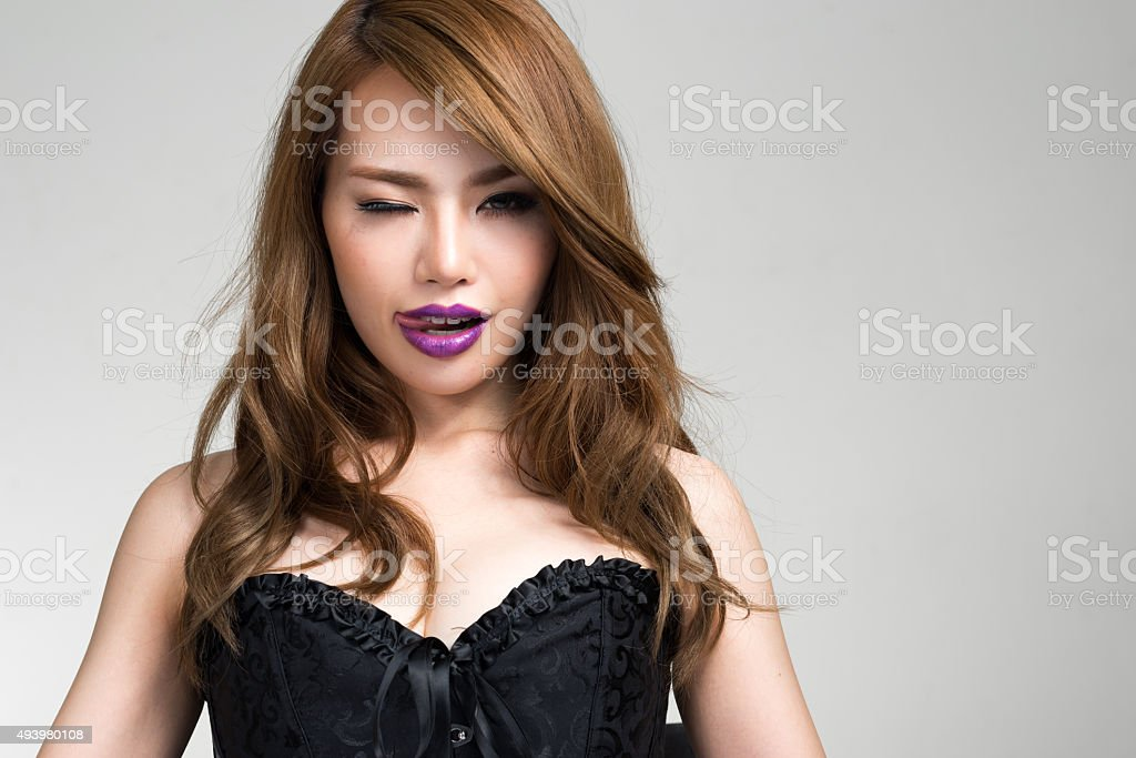 Portrait of Japanese woman winking stock photo