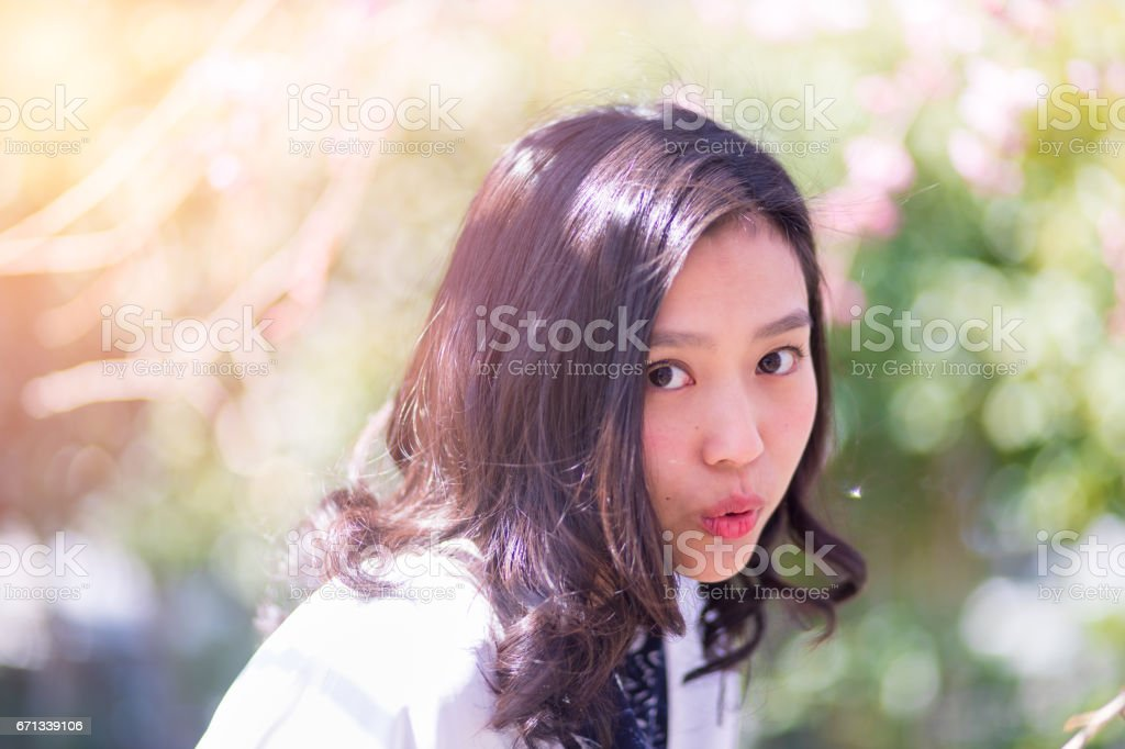 Portrait of Japanese young woman in forest stock photo