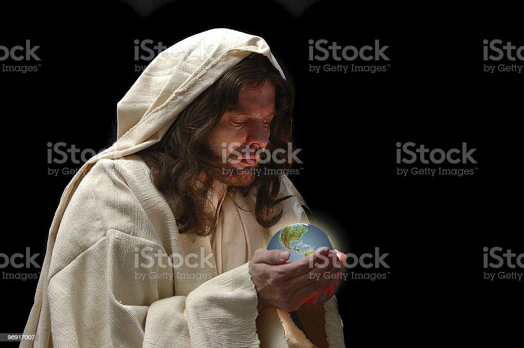 Portrait of Jesus holding the world royalty-free stock photo