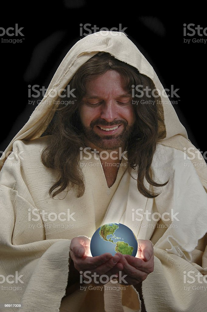 Portrait of Jesus holding the world royalty-free stock photo
