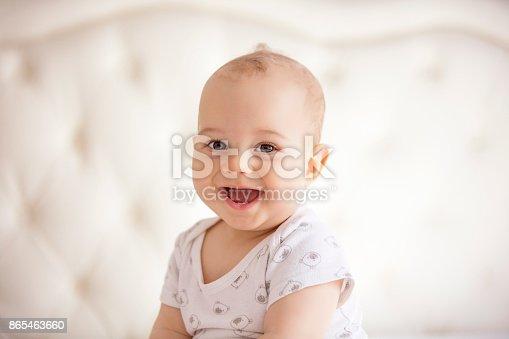 istock portrait of joyful baby boy 865463660