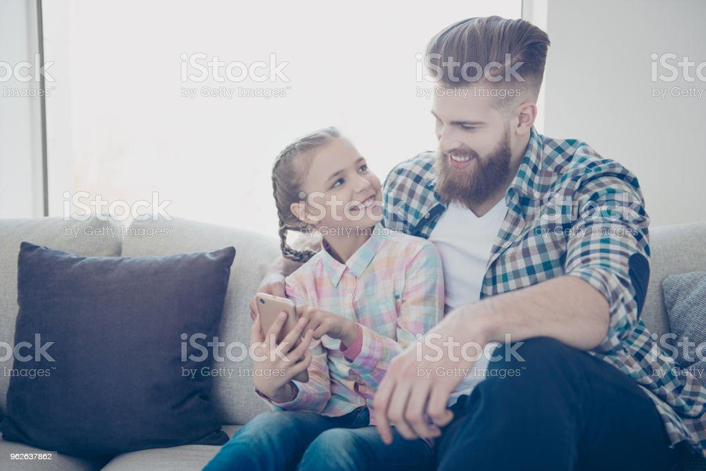 Portrait of joyful cheerful family with one parent, cute little girt...