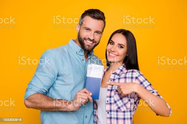 Portrait of joyful glad couple holding passport with flying tickets picture id1000830916?b=1&k=6&m=1000830916&s=612x612&h=l0d69yld mky6lgebk17wwwrefbyetnxdvjdi kxjmi=