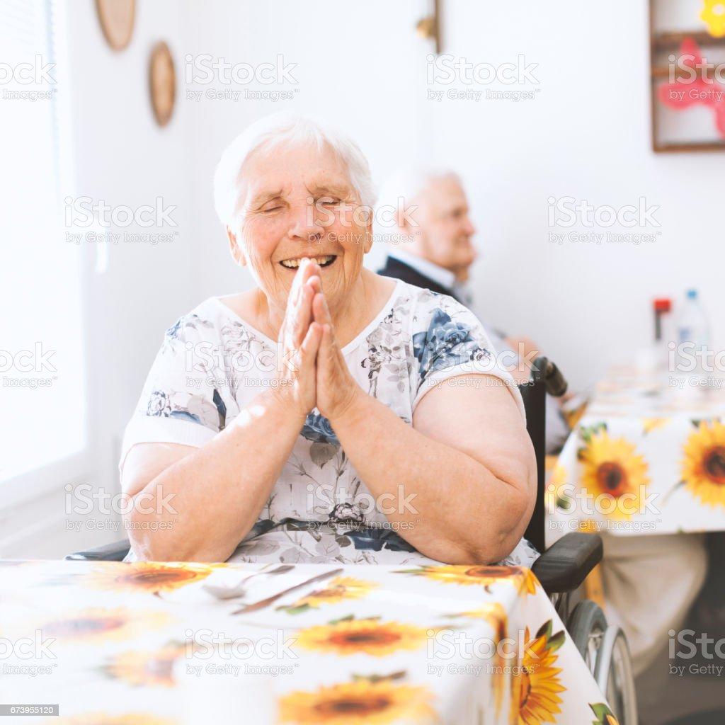 Portrait Of Joyful Senior Woman In The Nursing Home stock photo