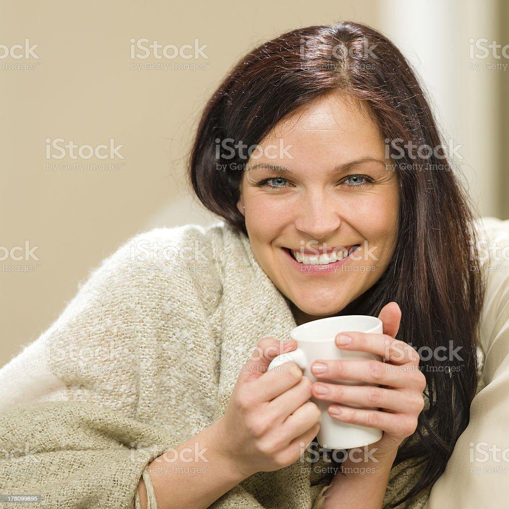 Portrait of joyful woman drinking hot beverage royalty-free stock photo