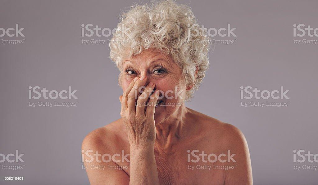 Portrait of joyous senor lady stock photo
