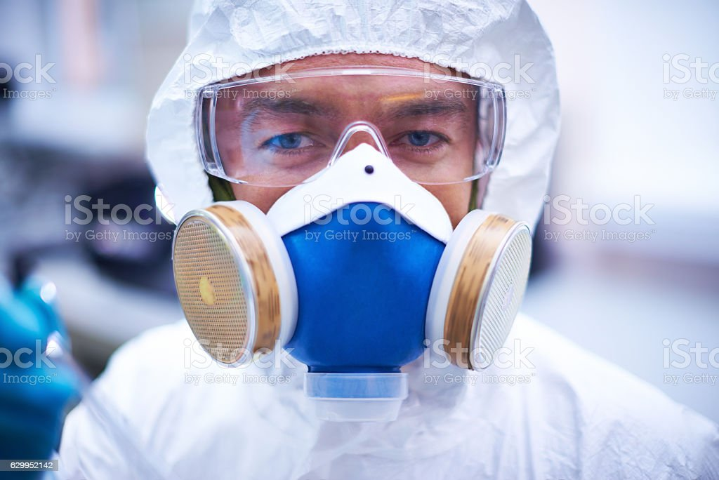 Portrait of lab worker wearing protective suit, eyewear and mask – Foto