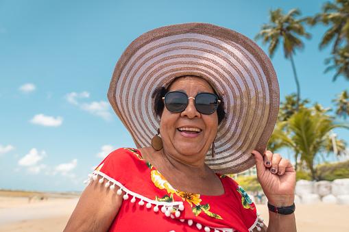 Portrait of Lady enjoying the tropical beach