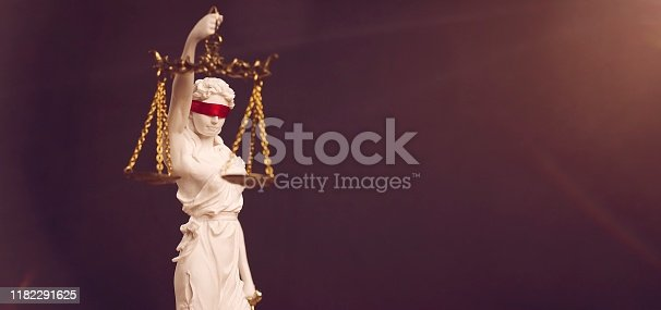istock Portrait of lady Justice with red blindfold. Panoramic image with copy space. 1182291625