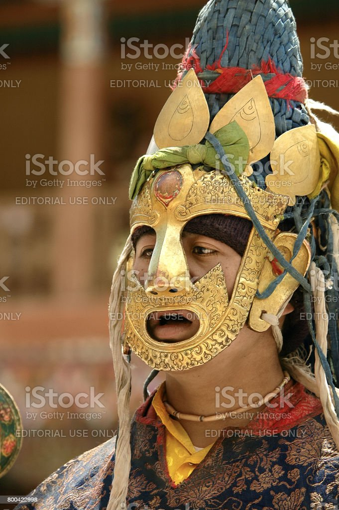 Portrait of Lama in the Sacred Brass Mask stock photo