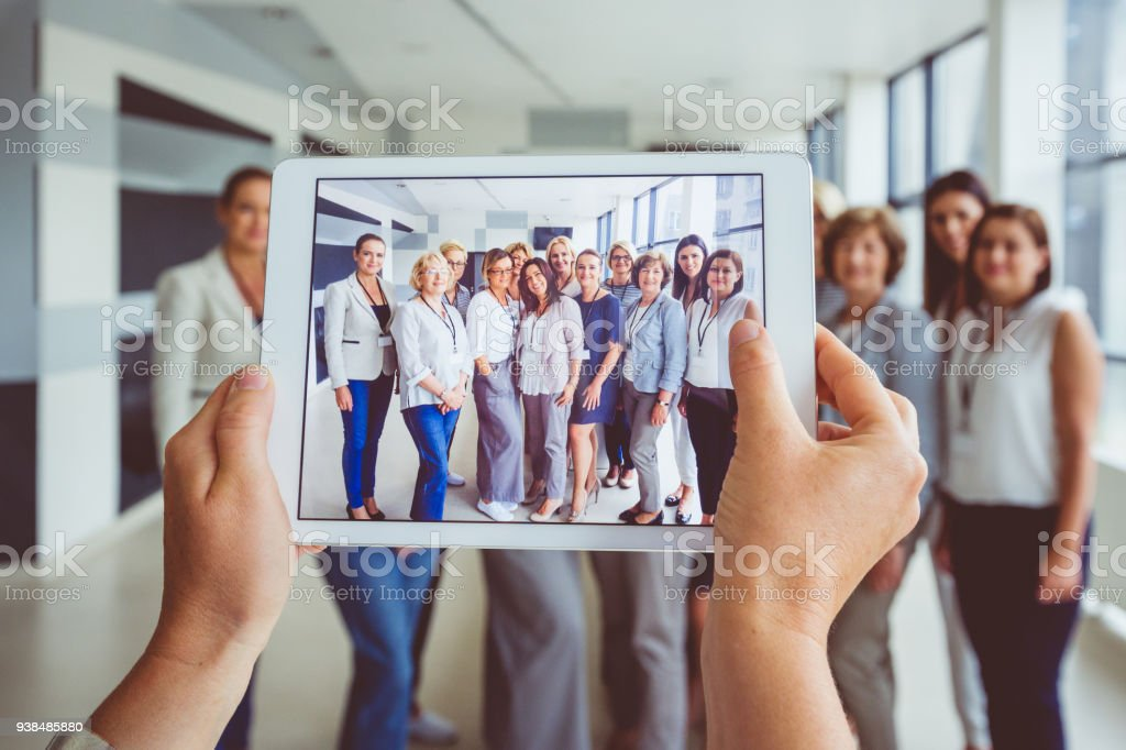 Portrait of large group of happy women after seminar Portrait of large group of happy woman after conference on digital tablet screen. Active Seniors Stock Photo