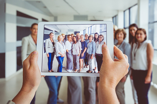 Portrait Of Large Group Of Happy Women After Seminar Stock Photo - Download Image Now