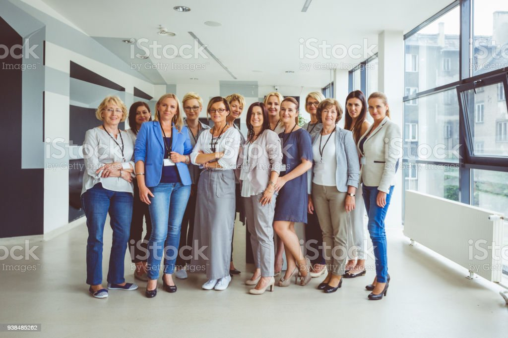 Portrait of large group of happy women on seminar Portrait of large group of happy woman during conference, smiling at the camera. Active Seniors Stock Photo