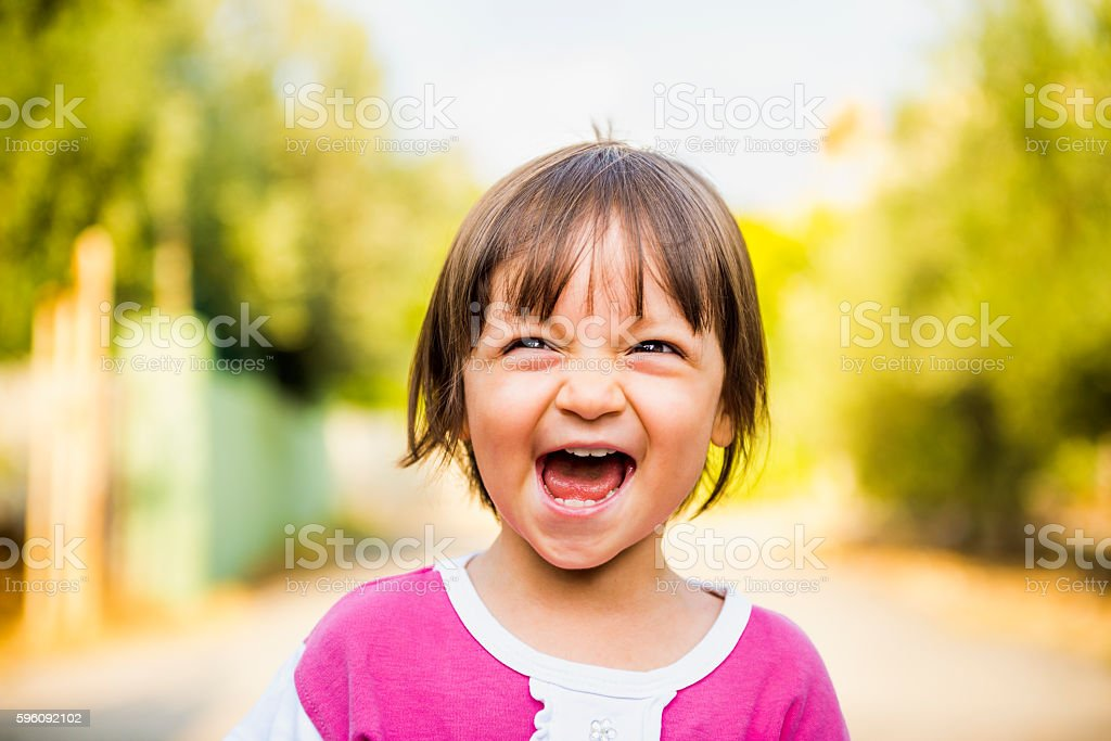 Portrait of laughing baby girl looking away with content smile Lizenzfreies stock-foto