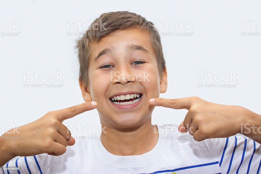 Portrait of laughing boy showing his clean, white teeth stock photo