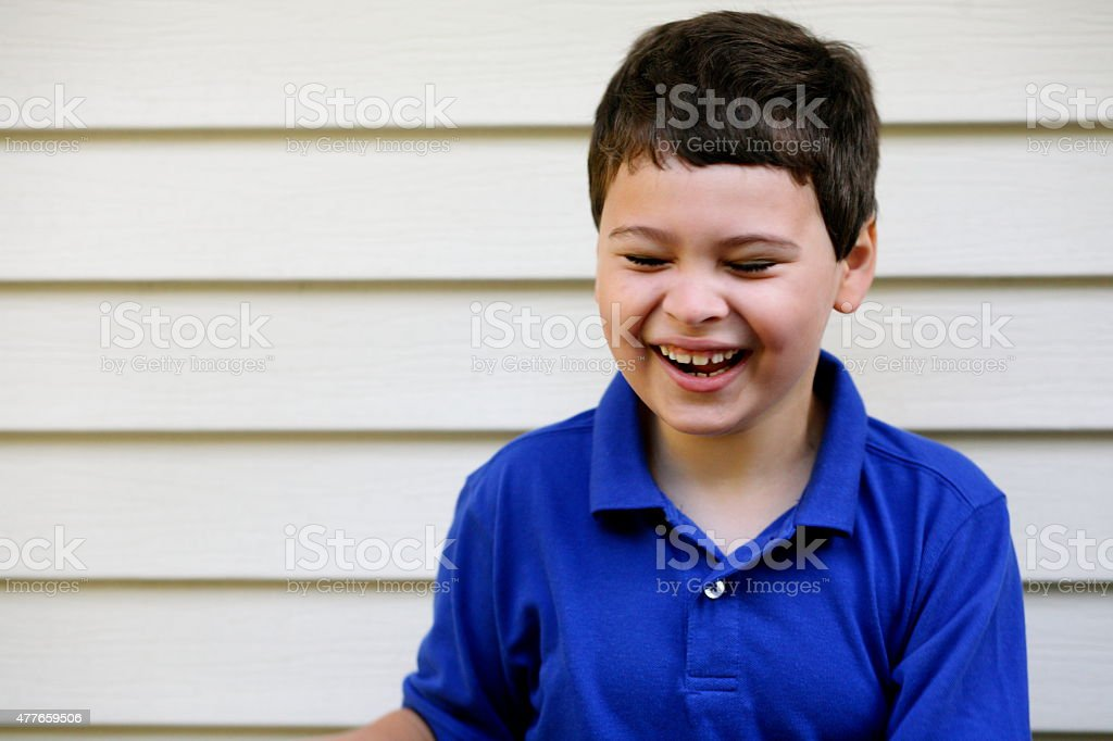 Portrait of laughing boy with autism stock photo