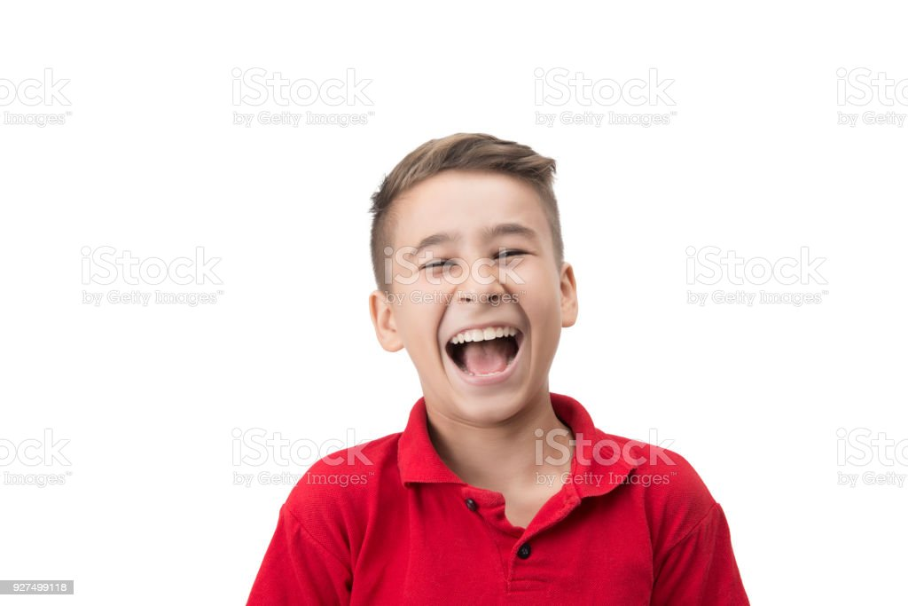 Portrait of laughing child looking at camera over white background stock photo