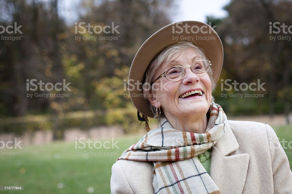 portrait of laughing senior woman with hat and toothy smile royalty-free stock photo