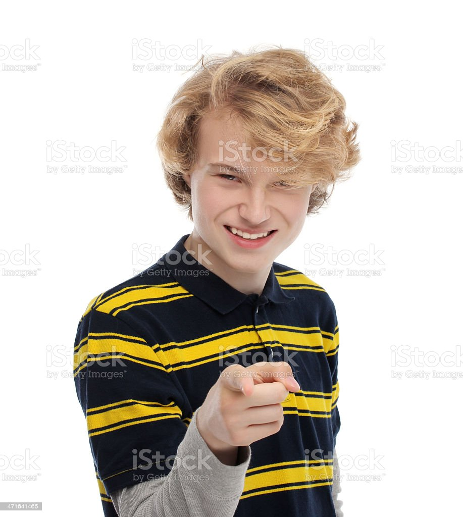 Portrait of laughing teenage boy pointing at the camera. royalty-free stock photo