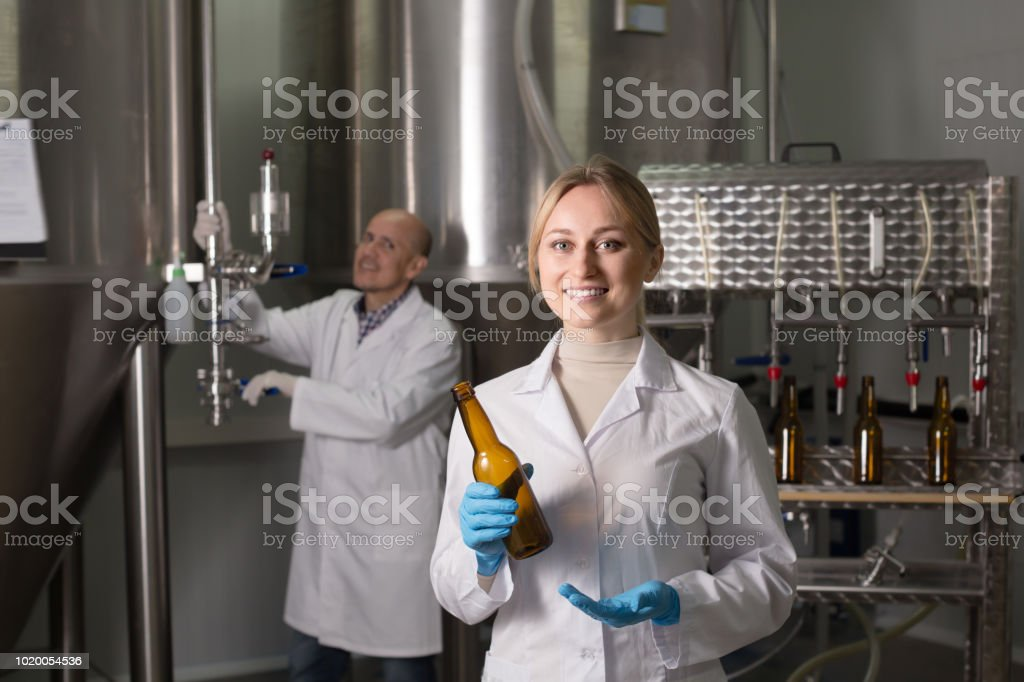 Portrait of laughing young woman employee stock photo