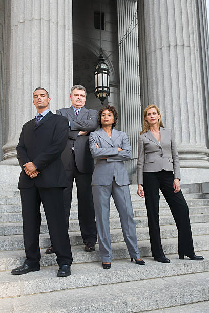 portrait of lawyers - four lawyers stockfoto's en -beelden