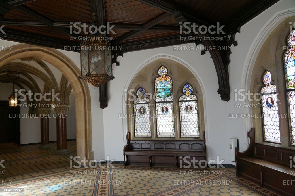 Portrait of Lincoln, Edison, Carnegie and the Niagara Falls as stained-glass windows. Bavaria, Munich New Town Hall. stock photo
