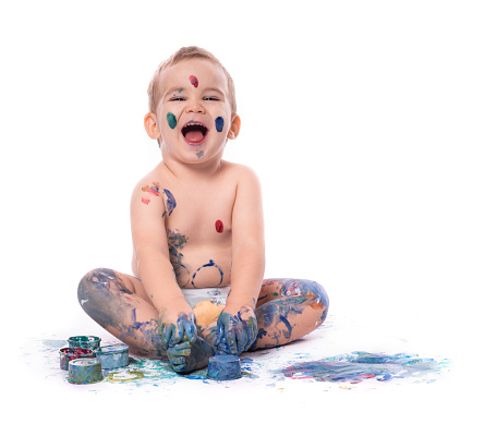 1042756824 istock photo Portrait of  Little Baby Boy Playing with Finger Paints 1179329380