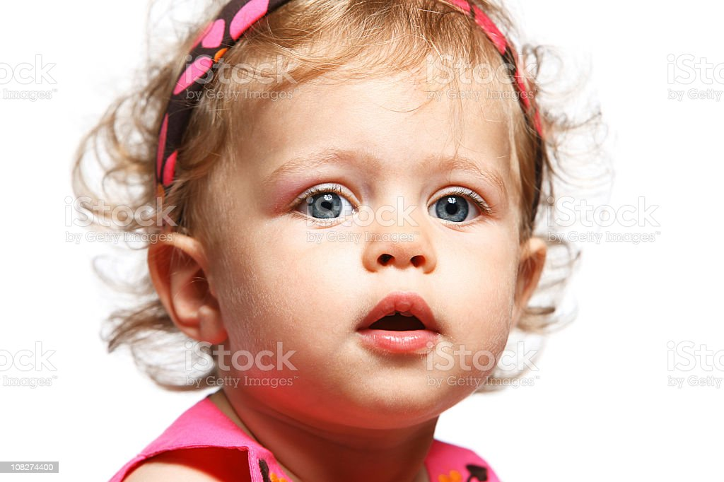 Portrait of Little Baby Girl Wearing Pink on White Background stock photo