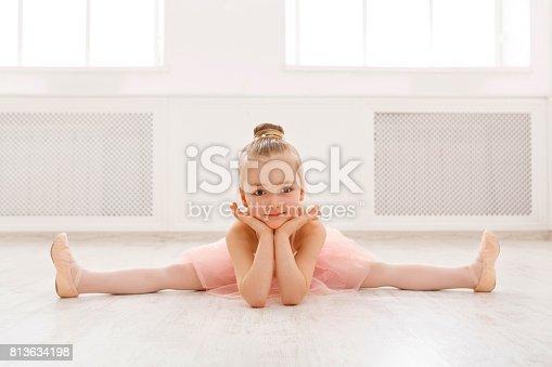 819677734 istock photo Portrait of little ballerina on floor, copy space 813634198
