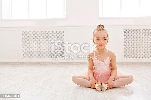 istock Portrait of little ballerina on floor, copy space 819677734