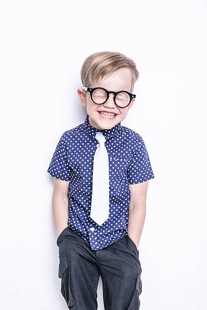 Portrait of little boy in funny glasses and tie. Fashion. stock photo