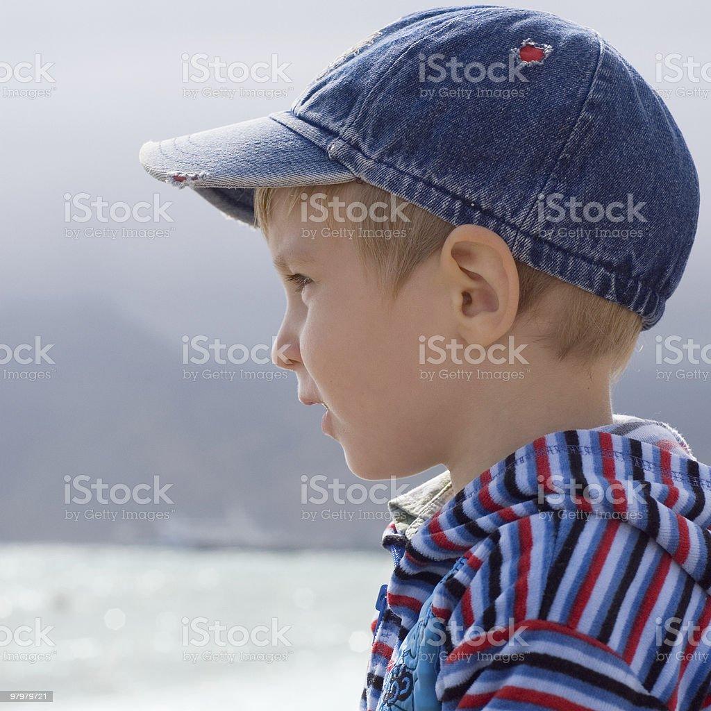 portrait of little boy in profile royalty-free stock photo