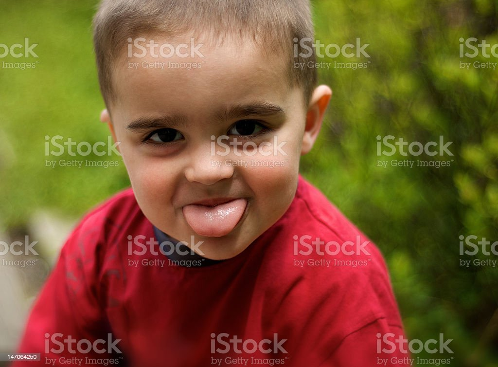 portrait of little boy in red t-shirt royalty-free stock photo