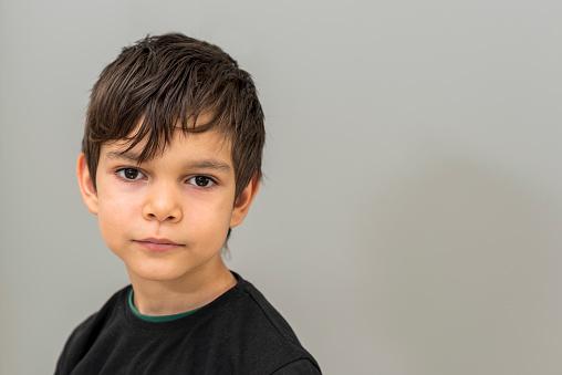 Portrait of little boy lookingat camera