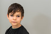 istock Portrait of little boy lookingat camera 1300675454