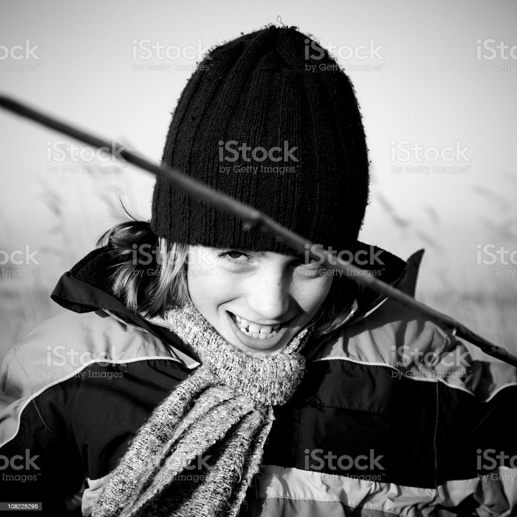 Portrait of Little Boy Outside on Cold Day Holding Stick royalty-free stock photo