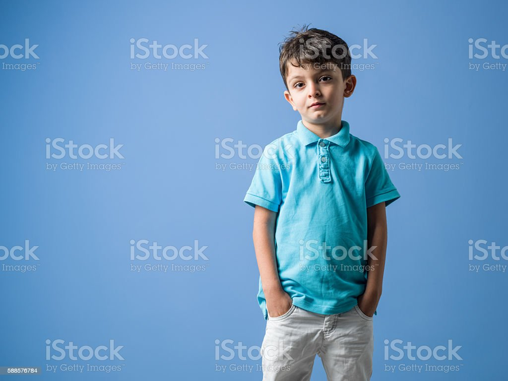 Portrait Of Little Boy Wearing Casual Clothings stock photo