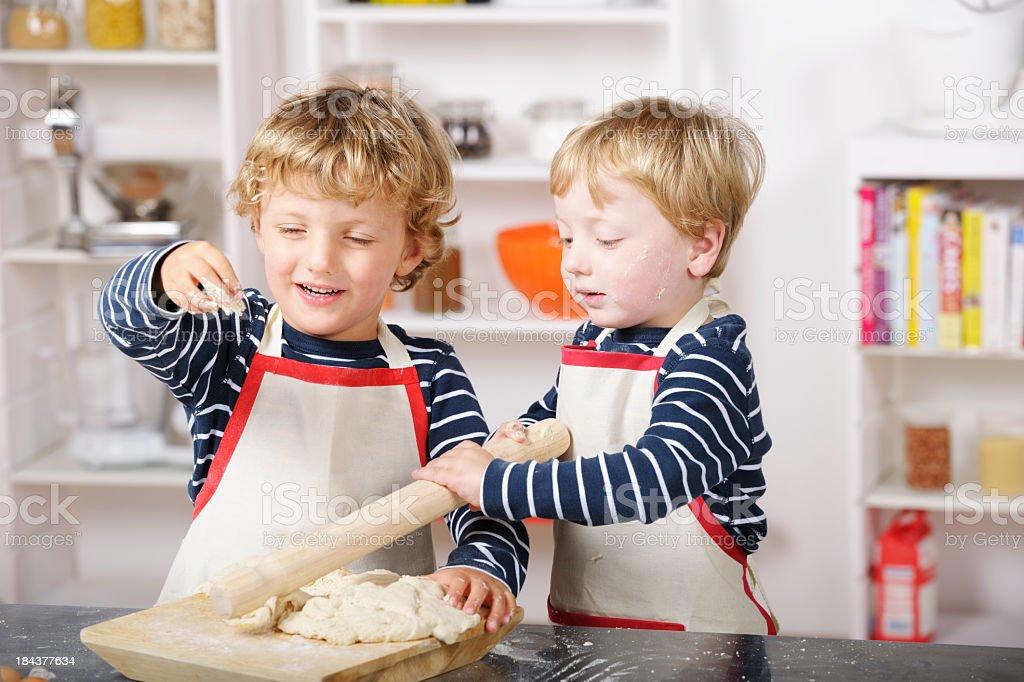 Portrait Of little Boys Preparing Dough royalty-free stock photo