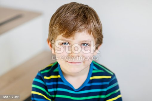 istock Portrait of little cute school kid boy in colorful clothes 655717982