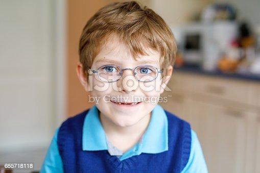 933458532 istock photo Portrait of little cute school kid boy with glasses 655718118