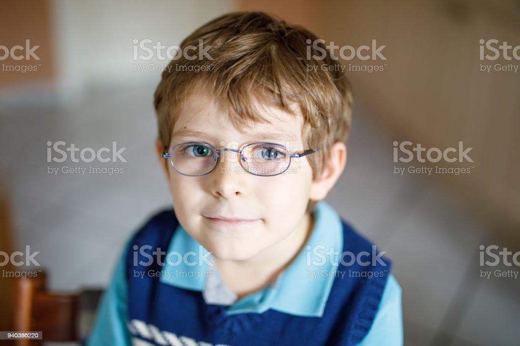 Portrait Of Little Cute School Kid Boy With Glasses Stock Photo