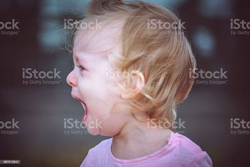Portrait of little girl crying stock photo