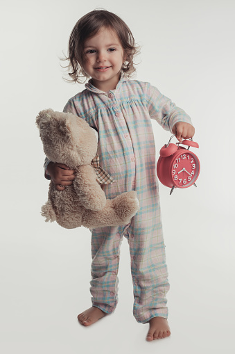 Portrait Of Little Girl Holding Alarm Clock And Teddy Bear ...Little Girl With Teddy Bear Black And White